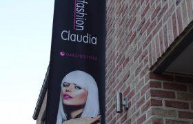 Muur banner kapster Claudia